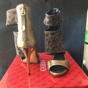 Cayen animal print bronze cutout heels.